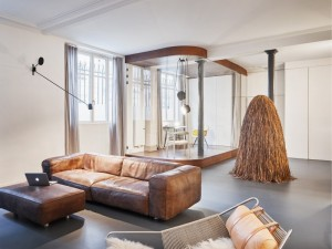 Parisian apartment with a gorgeous interior design customized with walnut and glass