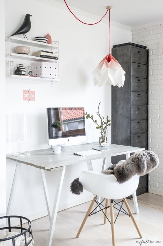 A living room workspace with a great light fixture
