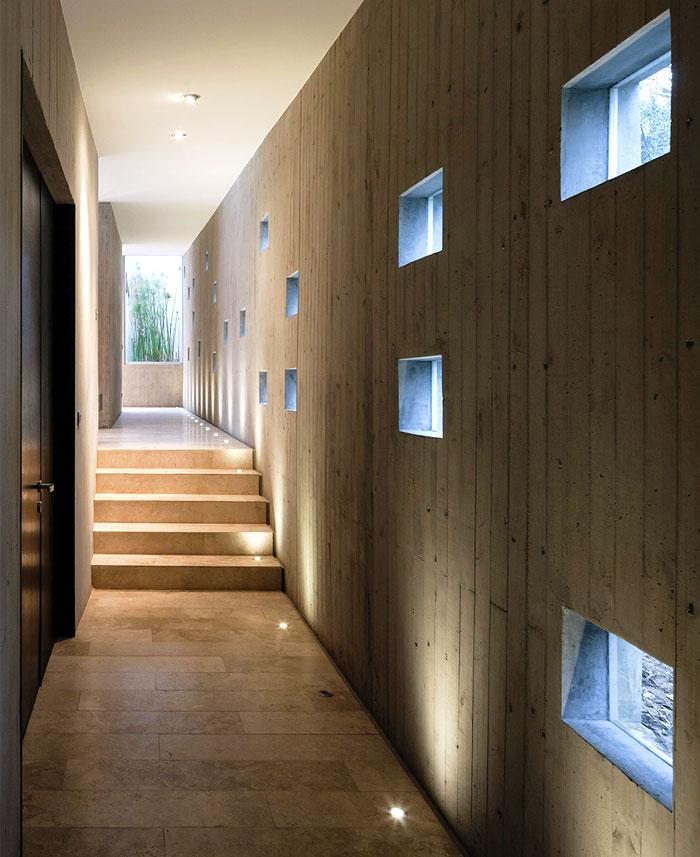 Fortress-Like Futuristic Concrete House – InteriorZine