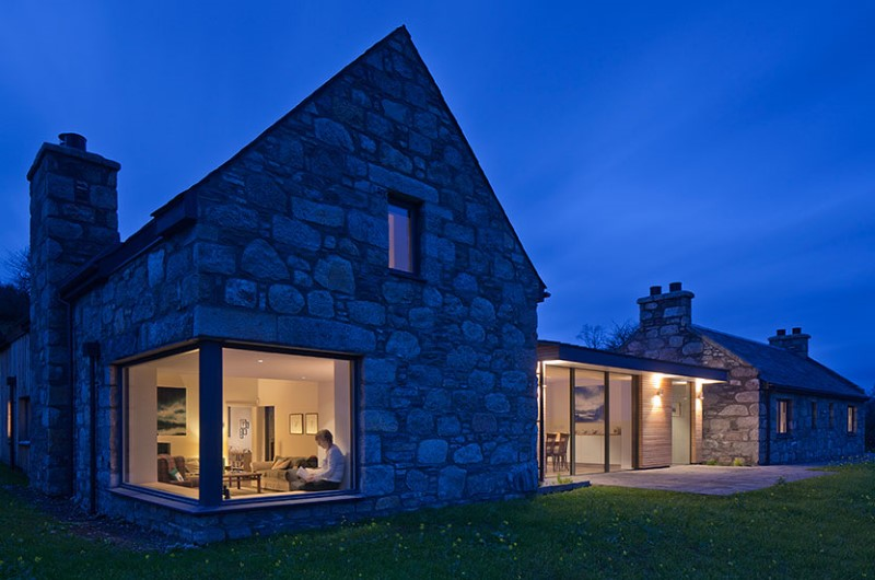 Scottish cottage nestled on a hillside with panoramic views