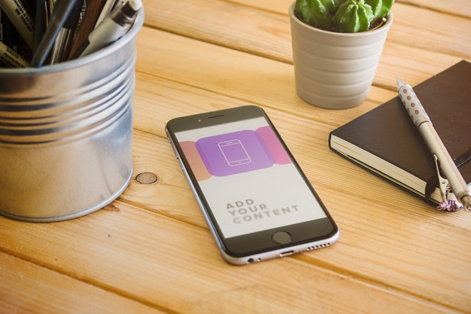 Free Realistic iPhone 6 Mockup on Wooden Table – Freebiesjedi