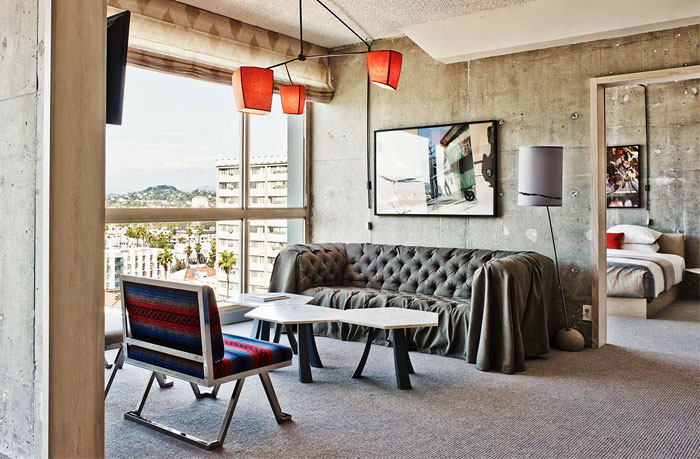 Hotel with Concrete Walls and Vintage Decor – InteriorZine