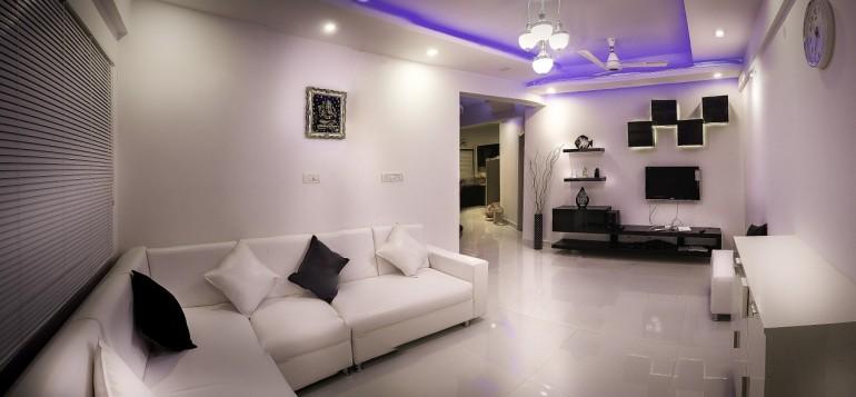 Sleek interior design in black & white, with purple lighting.