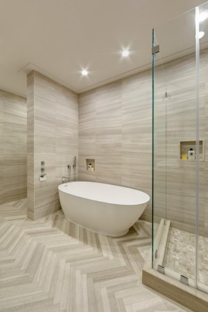 High ceiling & herringbone tile floors by Artistic Tile
