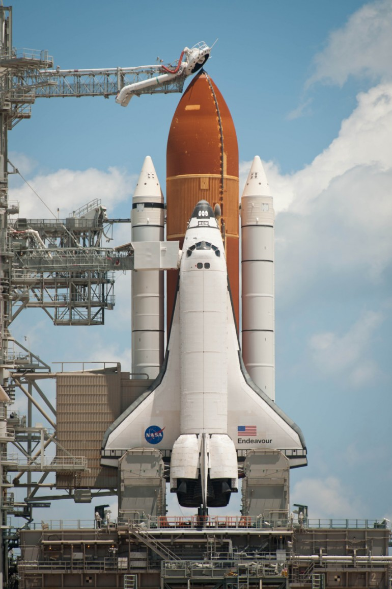 NASA shuttle Endeavour on launch pad.