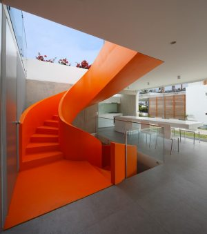Casa Blanca Has a Striking Orange Staircase That Connects All Indoor Areas