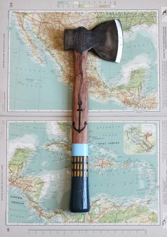 A painted axe on an Americas map