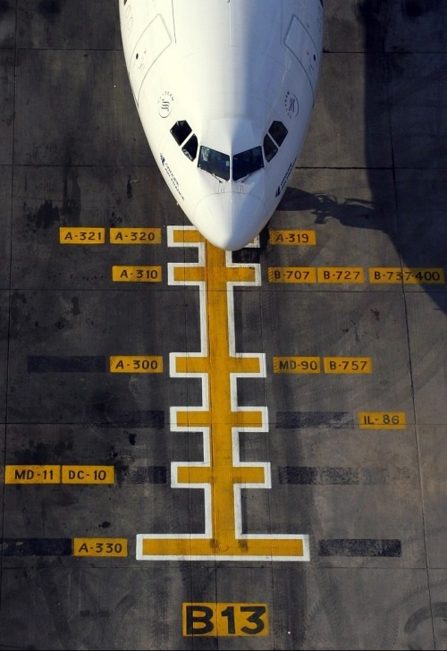 A parked plane on a runway