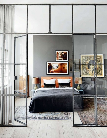 Glass wall with industrial frames in living room