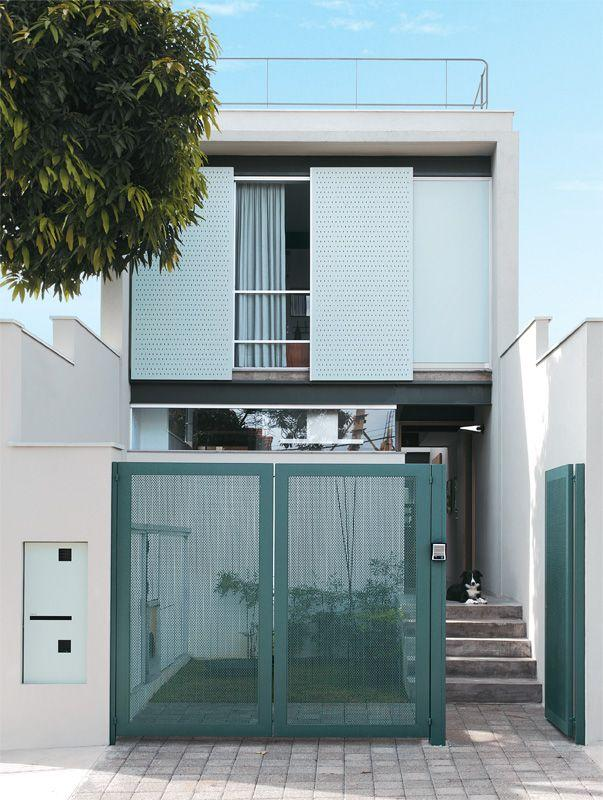 Facade of Narrow House with Green Gate