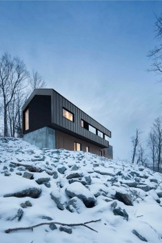 Quebec Country House Consisting of Two Stacked Volumes