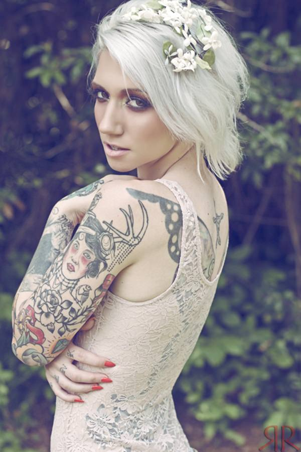 Fashion Female Model With Whole Body Tattoo