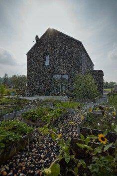 Carbon House: Two-Storey Rural House with a Burnt Wood Exterior