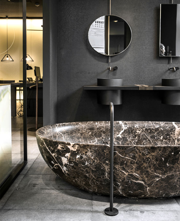 Emberador Marble and Black Bathroom