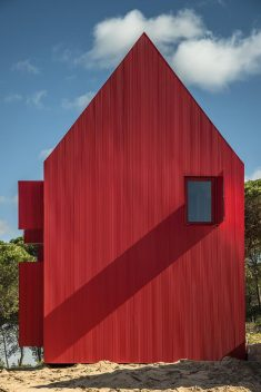 This Minimalist Red House Complements the Landscape as a 'Overwhelmingly Visible' Structure