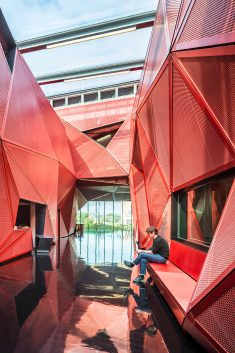 Faceted Red Metal Creates Sculptural Facade For Music Centre by Périphériques