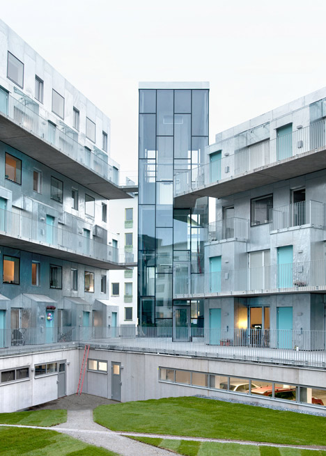 Metal-clad housing by Joliark features boxy balconies